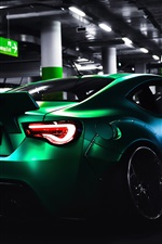 Preview iPhone wallpaper Toyota green supercar rear view, parking