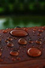 Preview iPhone wallpaper Water drops, wood surface