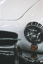 White Mercedes-Benz car, front view, lights