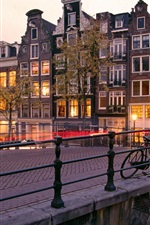 Preview iPhone wallpaper Amsterdam, Nederland, city, houses, bridge, lights, dusk