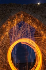 Preview iPhone wallpaper Arch, sparks, night
