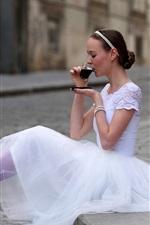 Ballet girl drinking tea