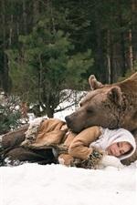 Bear and girl sleeping, winter, snow