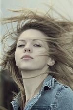 Preview iPhone wallpaper Blonde girl, hair flying, wind, grass