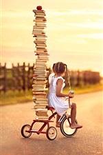 Child girl, little bike, many books