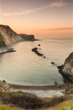 Preview iPhone wallpaper England, bay, sea, rocks, grass, beach, sunset