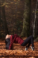 Preview iPhone wallpaper Girl dance in forest, leaves, autumn