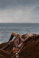 Preview iPhone wallpaper Girl sleep on the stone, sea