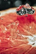 Preview iPhone wallpaper Grapefruit cut slice, water splash