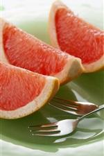 Preview iPhone wallpaper Grapefruit slice, spork