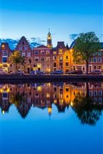 Preview iPhone wallpaper Haarlem, Netherlands, Spaarne river, city, dusk, lights, houses, reflection