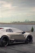 Lamborghini sports car, river, clouds