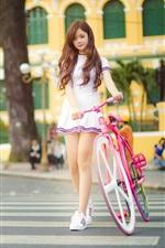 Lovely Asian girl, pink bike, street