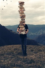 Many books, stacking, man, mountain top