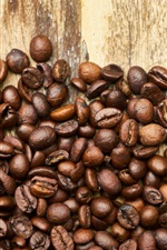 Preview iPhone wallpaper Many coffee beans, wood board