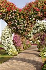 Preview iPhone wallpaper Miracle Garden, geranium, petunia, arch, path, Singapore