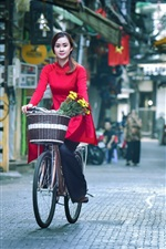 Preview iPhone wallpaper Red dress Asian girl ride bike at street
