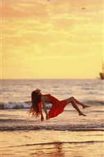 Preview iPhone wallpaper Sea, waves, red dress girl float