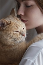 Preview iPhone wallpaper Short hair girl hugging a cat