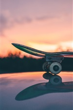 Preview iPhone wallpaper Skateboard close-up, sunset