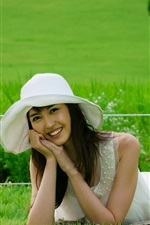 Preview iPhone wallpaper Smile Asian girl, grass, hat, summer