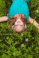 Preview iPhone wallpaper Smile girl, listen music, lying on grass