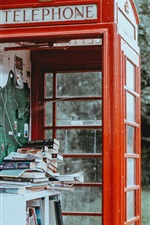 Preview iPhone wallpaper Telephone booth, books
