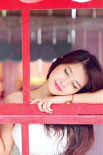 Asian girl intoxicated to smile, window