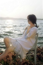 Preview iPhone wallpaper Asian girl look at sea, chair, sun