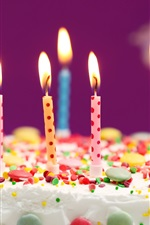 Birthday cake, colorful candles, flame