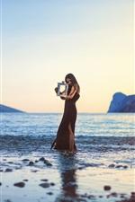 Black dress girl, sea, coast, lamp