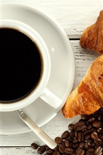 Croissants, coffee beans, cup