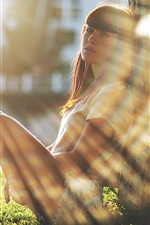 Preview iPhone wallpaper Girl sit at tree side, sunshine, glare