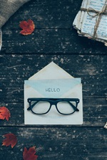 Glasses, envelope, letters, coffee, cloth