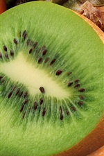 Preview iPhone wallpaper Half of kiwi macro photography