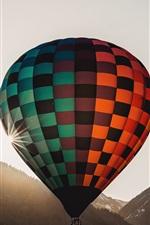 Hot air balloon flight, sun, mountains
