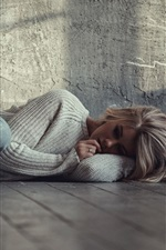 Preview iPhone wallpaper Sadness blonde girl, sleep on floor