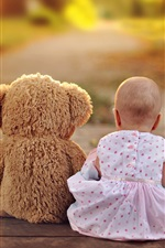 Preview iPhone wallpaper Teddy bear and child girl rear view