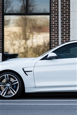 White BMW car side view, street, house