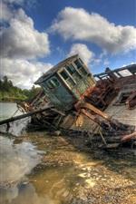 Broken boat, river