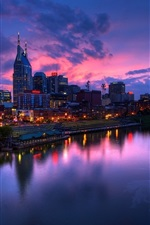 Preview iPhone wallpaper City, sunset, buildings, lights, river, boats, red sky