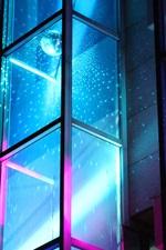 Glass window, neon light, night
