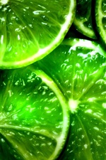 Preview iPhone wallpaper Green lemon slices, fruit close-up