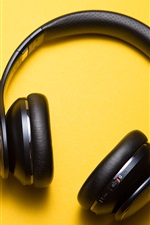 Preview iPhone wallpaper Headphones, yellow background