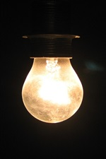 Preview iPhone wallpaper Light bulb in the darkness
