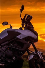 Preview iPhone wallpaper Motorcycle at sunset, clouds