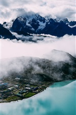 Preview iPhone wallpaper Mountains, fog, houses, lake, top view