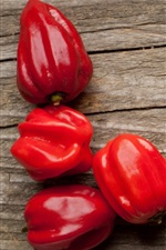 Preview iPhone wallpaper Red peppers, wood background, vegetables