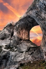 Preview iPhone wallpaper Rocks, hole, red sky, sunset