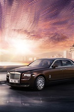 Preview iPhone wallpaper Rolls Royce Ghost luxury car, brown, city, sunset